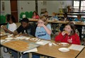 102808 Brunson Dargan Taste Testing A group of students at Brunson Dargan Elementary School taste-test potential school lunch menu items and condiments.